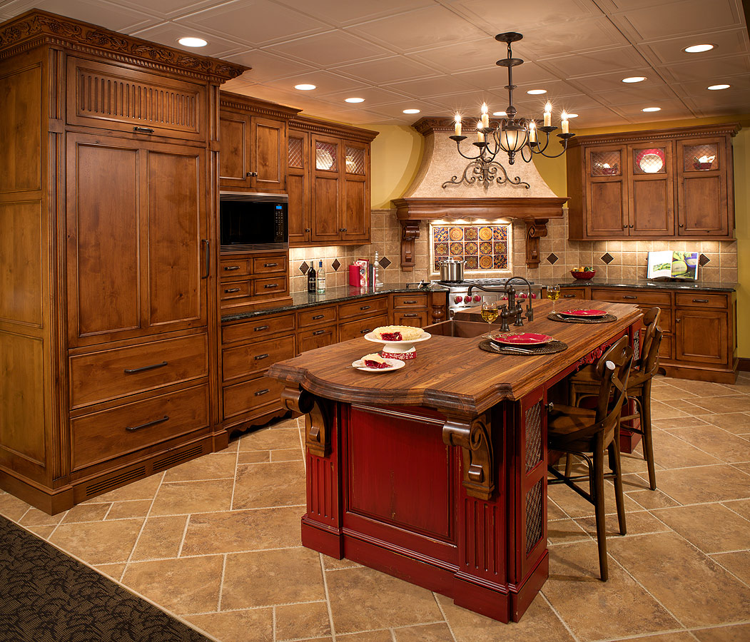 Mullet cabinet tuscan inspired kitchen for Red kitchen designs photo gallery
