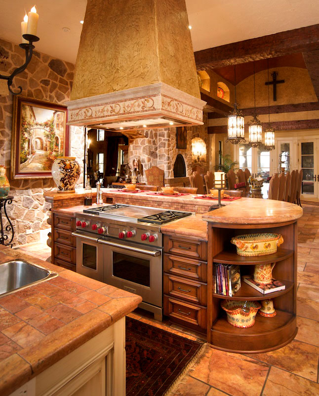 Mullet cabinet mediterranean tuscan style kitchen for Cooktop kitchen island designs