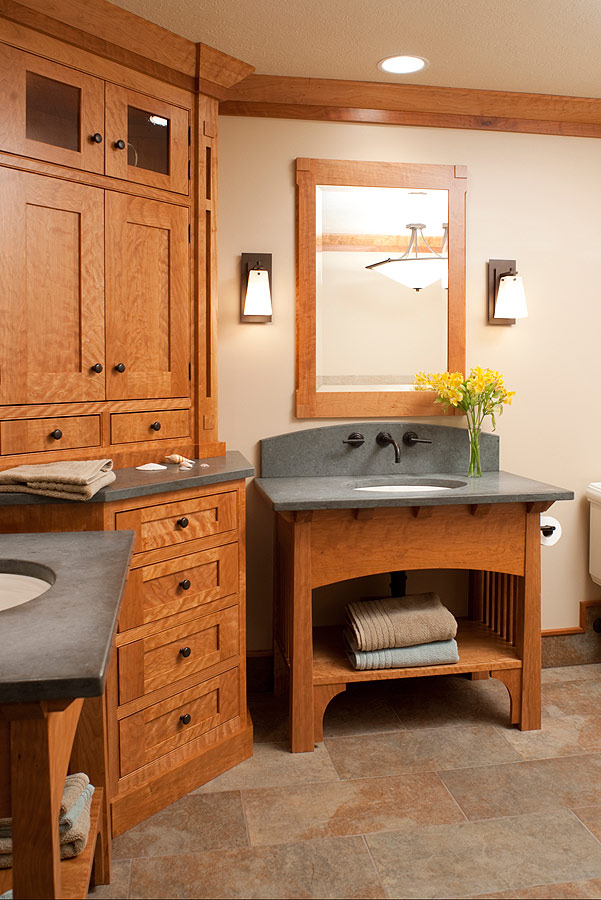 A Curly Cherry Arts And Crafts Master Bath Features Dual Vanities With  Slate Tops For Him And Her, A Corner Linen Cabinet, And Framed Mirrors.
