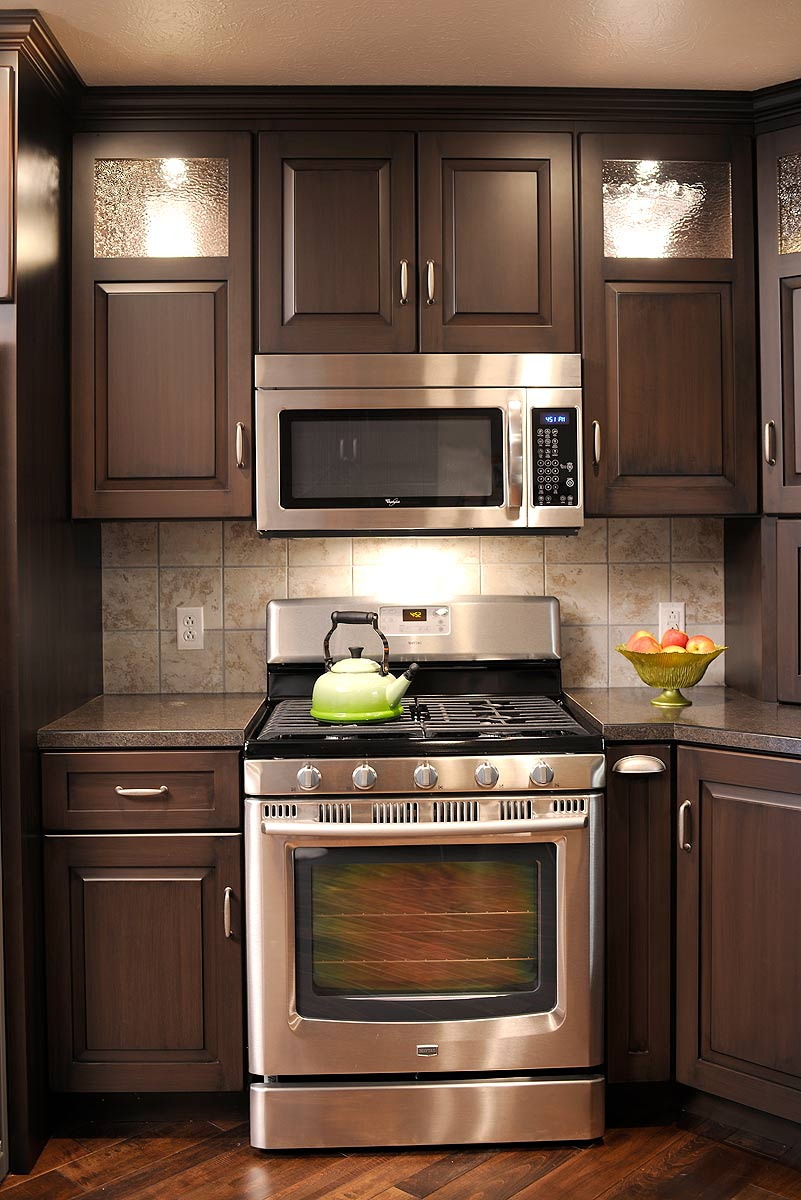 Mullet cabinet brown condominium kitchen for Kitchen ideas brown cabinets