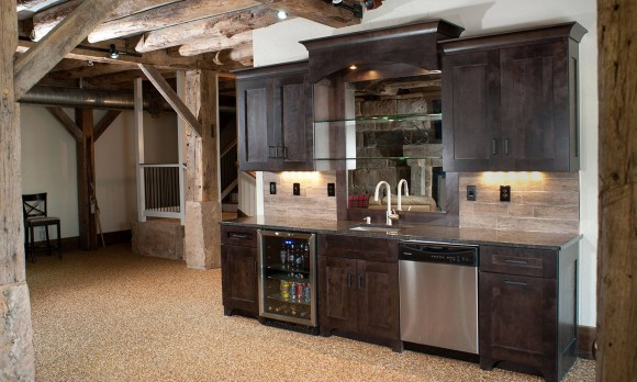 in this elegant basement bar surround by the timber frame structure